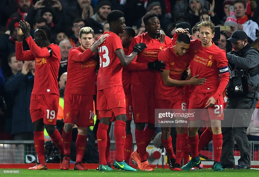 Divock Origi of Liverpool (C) celebrates with team mates as he scores their first goal during the EFL Cup Quarter-Final match between Liverpool and Leeds United at Anfield on November 29, 2016 in Liverpool, England.
