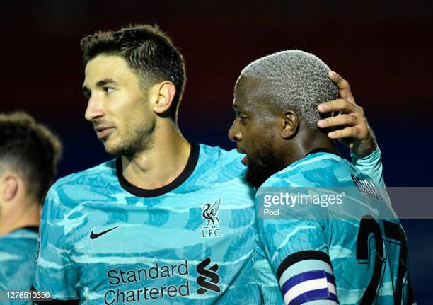 Divock Origi of Liverpool celebrates with teammate Marko Grujic after scoring his team's seventh goal during the Carabao Cup third round match...