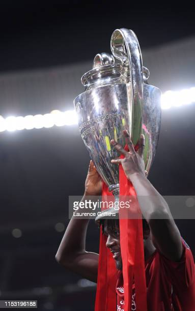 Divock Origi of Liverpool celebrates with the Champions League Trophy after winning the UEFA Champions League Final between Tottenham Hotspur and...