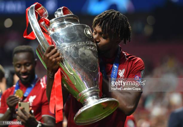 Divock Origi of Liverpool celebrates with the UEFA Champions League Trophy following his team's victory in the UEFA Champions League Final between...