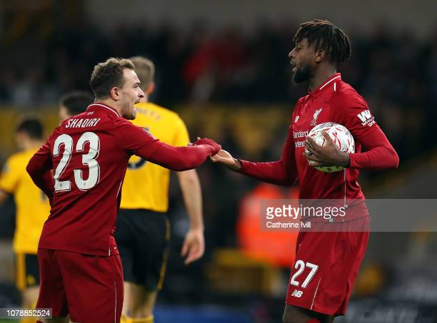 Divock Origi of Liverpool celebrates with Xherdan Shaqiri after scoring during the Emirates FA Cup Third Round match between Wolverhampton Wanderers...