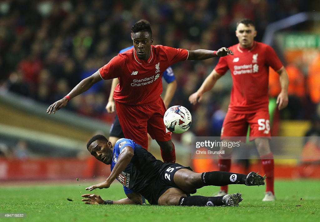 Divock Origi of Liverpool challenges Sylvain Distin of Bournemouth during the Capital One Cup Fourth Round match between Liverpool and AFC Bournemouth at Anfield on October 28, 2015 in Liverpool, England.