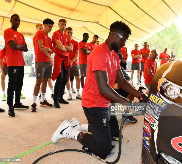 Divock Origi of Liverpool changing tyres during the tour of Roush Fenway Racing on July 21 2018 in Charlotte North Carolina