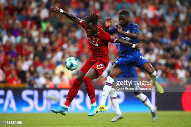 Divock Origi of Liverpool competes with Fikayo Tomori of Chelsea during the UEFA Super Cup match between Liverpool and Chelsea at Vodafone Park on...