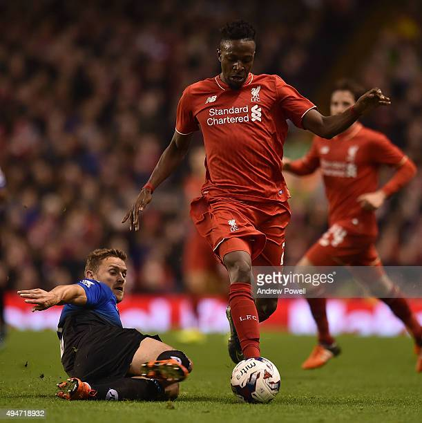 Divock Origi of Liverpool competes with Matt Ritchie of AFC Bournemouth during the Capital One Cup Fourth Round match between Liverpool and AFC...