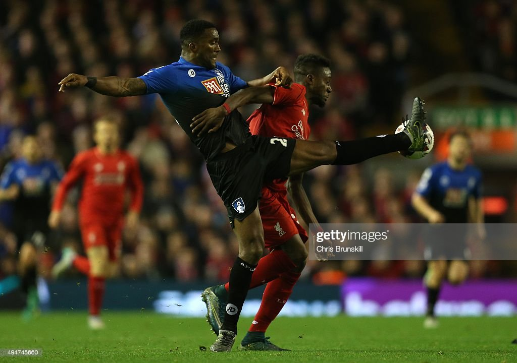 Divock Origi of Liverpool competes with Sylvain Distin of AFC Bournemouth during the Capital One Cup Fourth Round match between Liverpool and AFC Bournemouth at Anfield on October 28, 2015 in Liverpool, England.