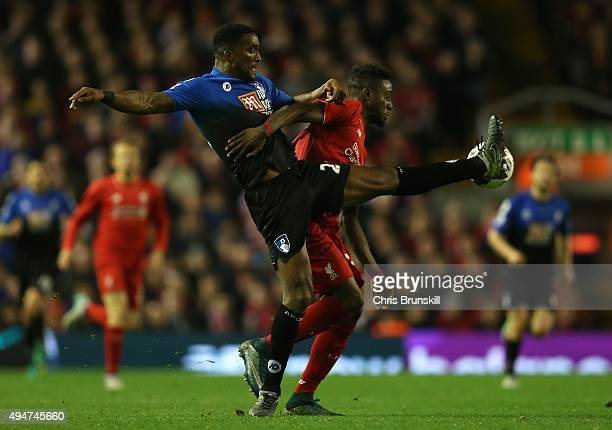 Divock Origi of Liverpool competes with Sylvain Distin of AFC Bournemouth during the Capital One Cup Fourth Round match between Liverpool and AFC...