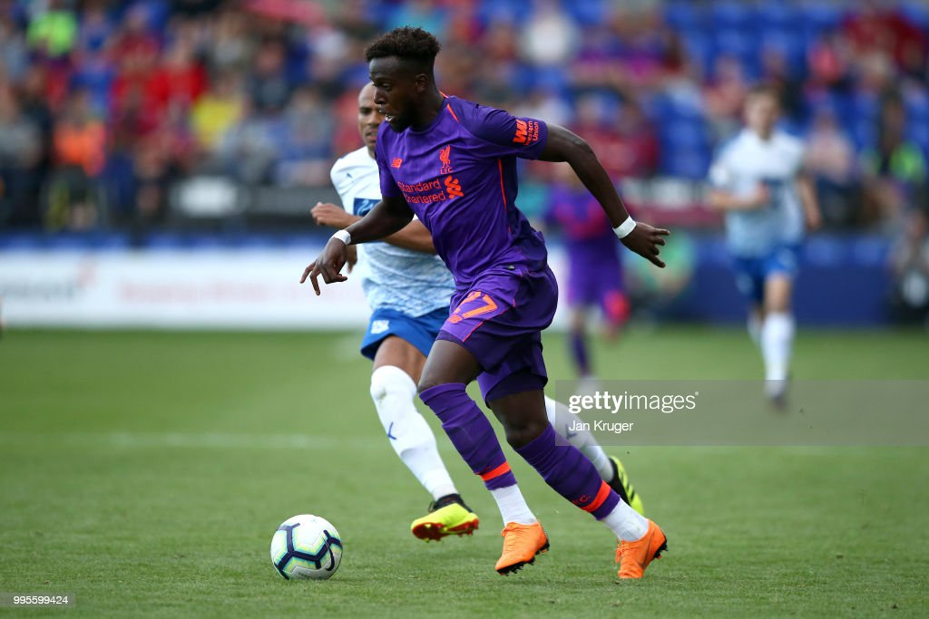 Divock Origi of Liverpool controls the ball during the Pre-Season Friendly match between Tranmere Rovers and Liverpool at Prenton Park on July 11, 2018 in Birkenhead, England.