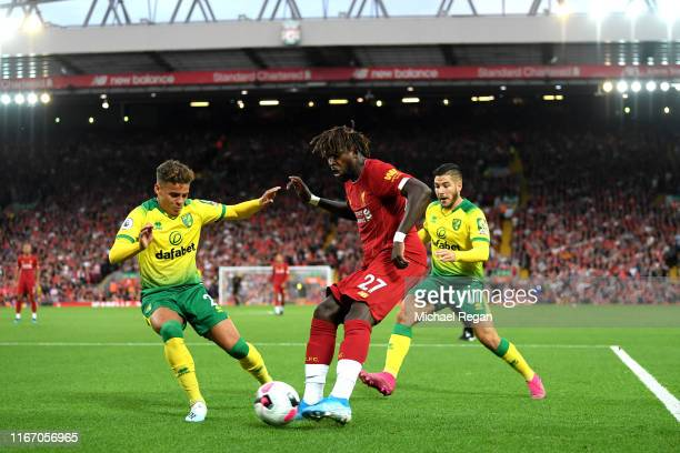 Divock Origi of Liverpool crosses the ball leading to the own goal of Grant Hanley of Norwich City during the Premier League match between Liverpool...