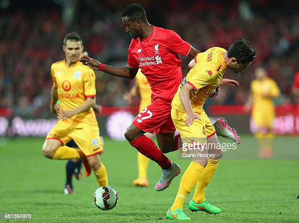 Divock Origi of Liverpool FC and Dylan McGowan of United compete for the ball during the international friendly match between Adelaide United and...