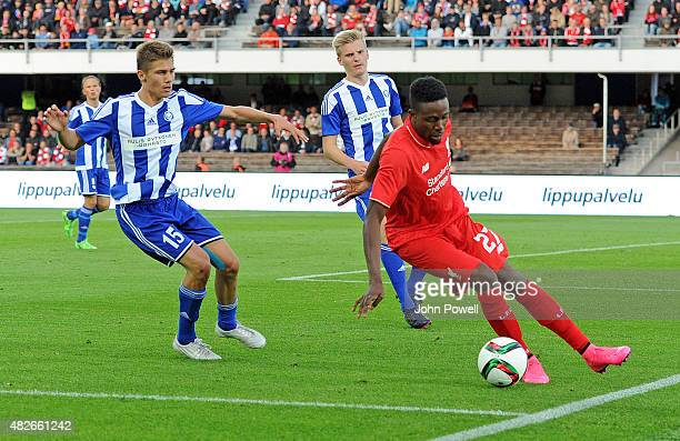 Divock Origi of Liverpool FC and Roni Peiponen of HJK Helsinki in action during the pre season friendly match at Olympic Stadium on August 1, 2015 in...