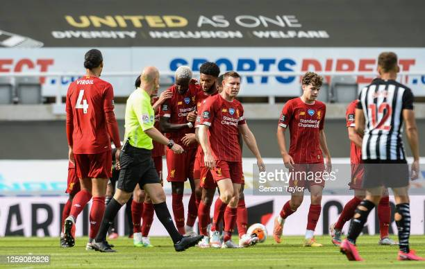 Divock Origi of Liverpool FC celebrates with teammates after scoring Liverpools second goal during the Premier League match between Newcastle United...
