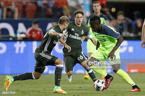 Divock Origi of Liverpool FC looks to get by Gabriel Paletta of AC Milan during the International Champions Cup match at Levi's Stadium on July 30,...