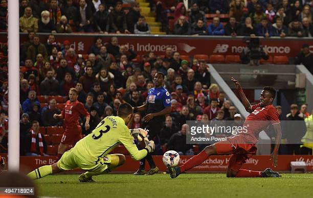 Divock Origi of Liverpool has a shot at Adam Federici of AFC Bournemouth during the Capital One Cup Fourth Round match between Liverpool and AFC...