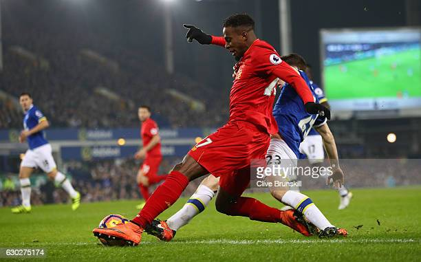 Divock Origi of Liverpool in action during the Premier League match between Everton and Liverpool at Goodison Park on December 19 2016 in Liverpool...