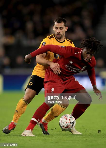 Divock Origi of Liverpool in action with Jonny Castro of Wolverhampton Wanderers during the Emirates FA Cup Third Round match between Wolverhampton...