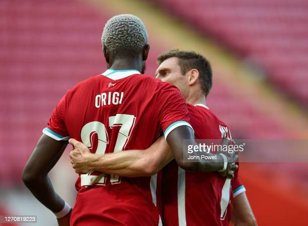 Divock Origi of Liverpool is congratulated by James Milner of Liverpool after his goal during the game at Anfield on September 05 2020 in Liverpool...