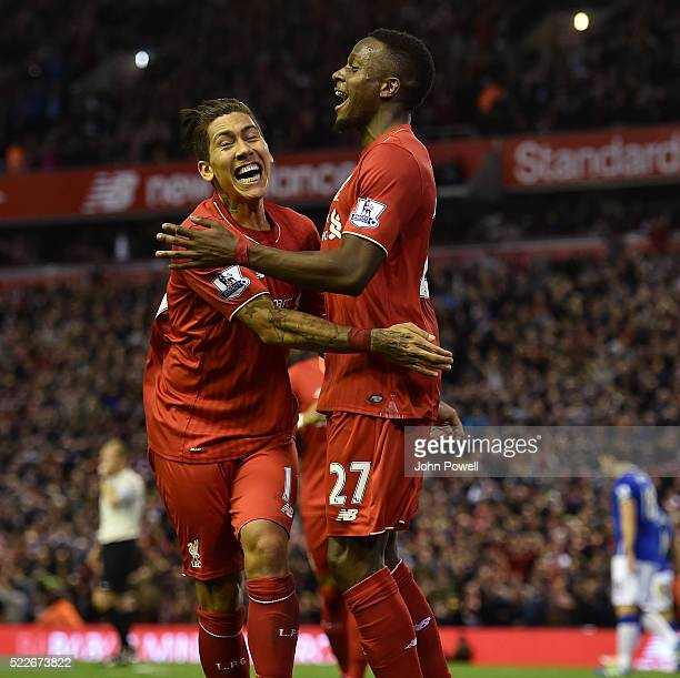 Divock Origi of Liverpool is congratulated by Roberto Firmino after his goal during the Barclays Premier League match between Liverpool and Everton...