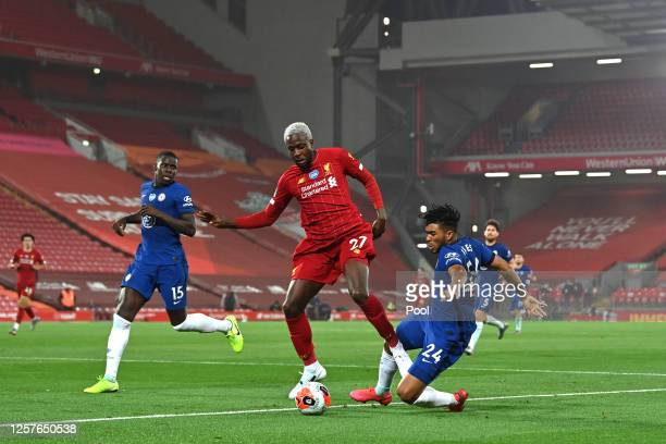 Divock Origi of Liverpool is tackled by Reece James of Chelsea during the Premier League match between Liverpool FC and Chelsea FC at Anfield on July...