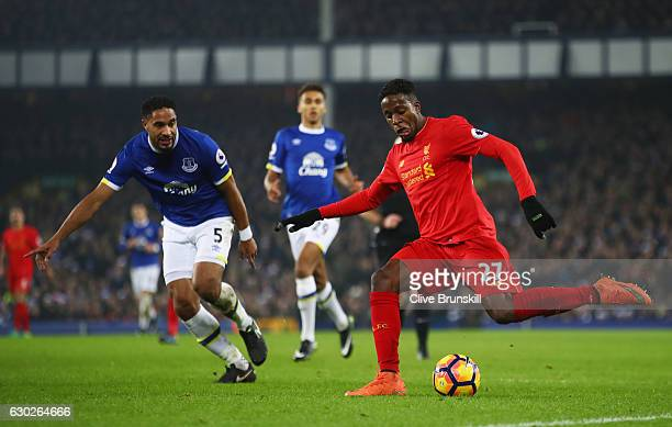 Divock Origi of Liverpool is watched by Ashley Williams of Everton during the Premier League match between Everton and Liverpool at Goodison Park on...