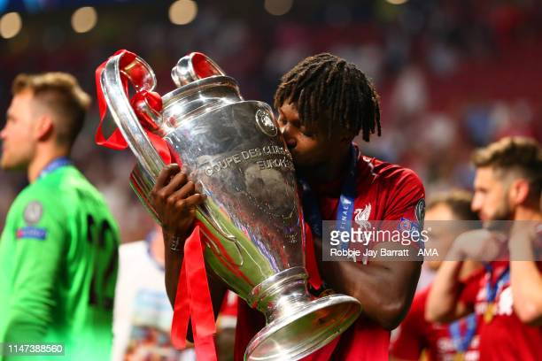 Divock Origi of Liverpool kisses the trophy at the end of the UEFA Champions League Final between Tottenham Hotspur and Liverpool at Estadio Wanda...