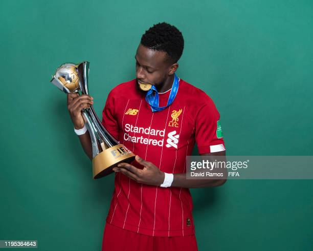 Divock Origi of Liverpool poses with the Club World Cup trophy after the FIFA Club World Cup Qatar 2019 Final match between Liverpool and CR Flamengo...
