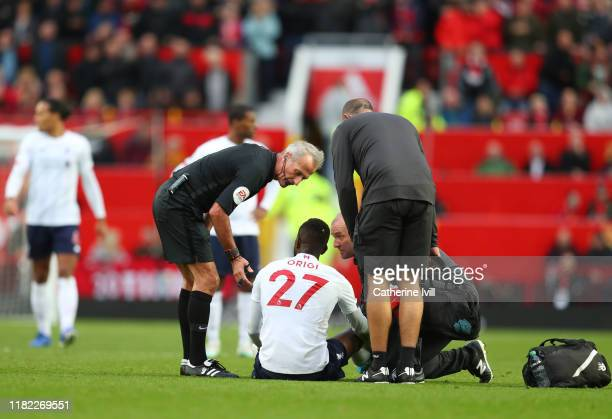 Divock Origi of Liverpool receives medical attention during the Premier League match between Manchester United and Liverpool FC at Old Trafford on...