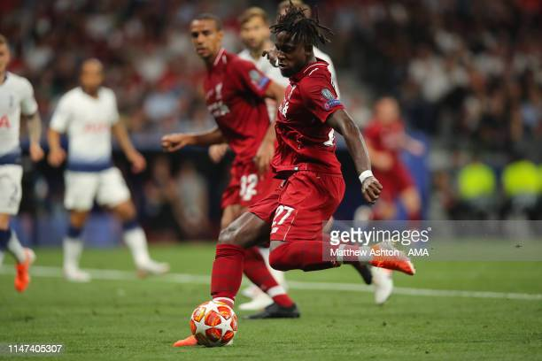 Divock Origi of Liverpool scores a goal to make it 02 during the UEFA Champions League Final between Tottenham Hotspur and Liverpool at Estadio Wanda...