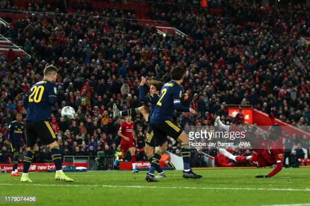 Divock Origi of Liverpool scores a goal to make it 5-5 during the Carabao Cup Round of 16 match between Liverpool and Arsenal at Anfield on October...