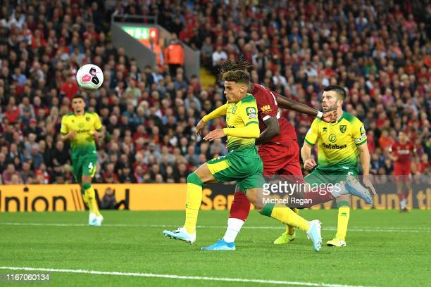 Divock Origi of Liverpool scores his sides fougoal during the Premier League match between Liverpool FC and Norwich City at Anfield on August 09 2019...