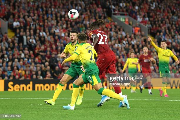 Divock Origi of Liverpool scores his sides fourth goal during the Premier League match between Liverpool FC and Norwich City at Anfield on August 09,...
