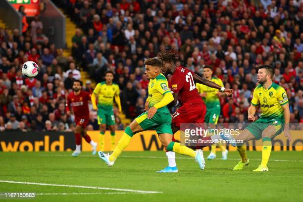 Divock Origi of Liverpool scores his side's fourth goal during the Premier League match between Liverpool FC and Norwich City at Anfield on August 09...