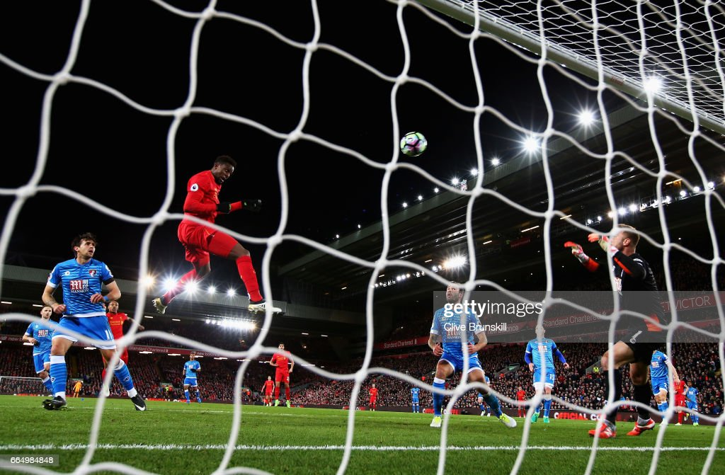 Divock Origi of Liverpool scores his sides second goal during the Premier League match between Liverpool and AFC Bournemouth at Anfield on April 5, 2017 in Liverpool, England.