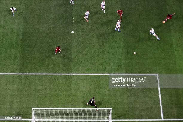 Divock Origi of Liverpool scores his sides second goal past Hugo Lloris of Tottenham Hotspur during the UEFA Champions League Final between Tottenham...