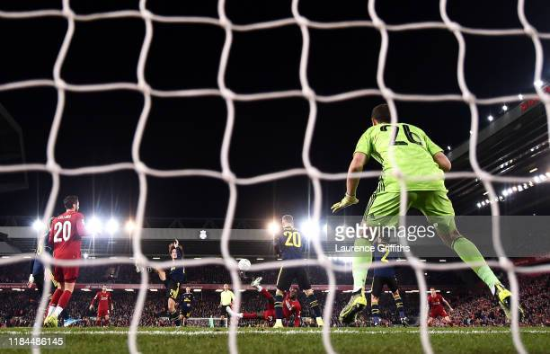 Divock Origi of Liverpool scores his team's fifth goal past Emiliano Martinez of Arsenal during the Carabao Cup Round of 16 match between Liverpool...