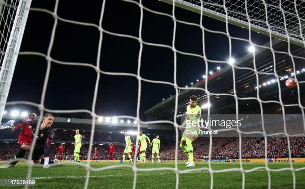 Divock Origi of Liverpool scores his team's fourth goal past MarcAndre Ter Stegan and Gerard Pique of Barcelona during the UEFA Champions League Semi...