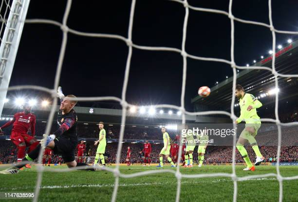 Divock Origi of Liverpool scores his team's fourth goal past MarcAndre Ter Stegan and Gerard Pique of Barcelona during the UEFA Champions League Semi...