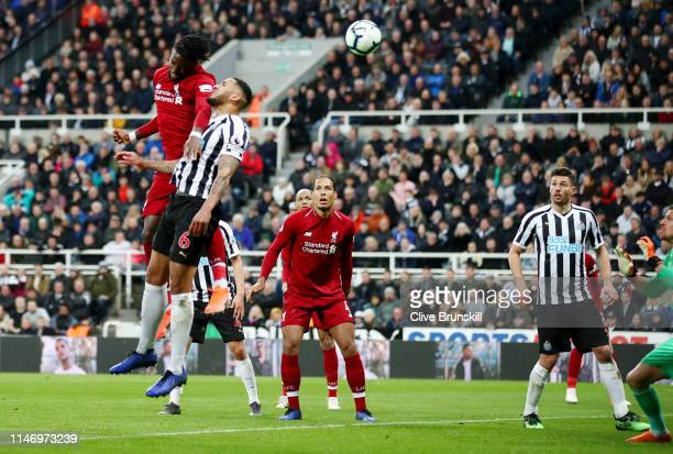 Divock Origi of Liverpool scores his team's third goal during the Premier League match between Newcastle United and Liverpool FC at St James Park on...