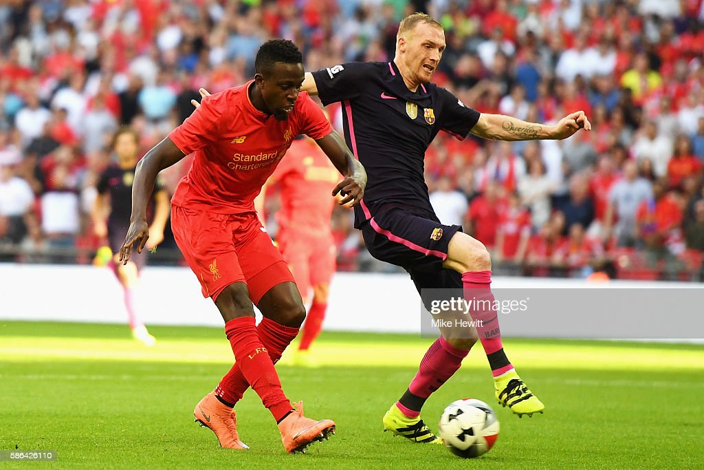 Divock Origi of Liverpool scores his team's third goal during the International Champions Cup match between Liverpool and Barcelona at Wembley Stadium on August 6, 2016 in London, England.