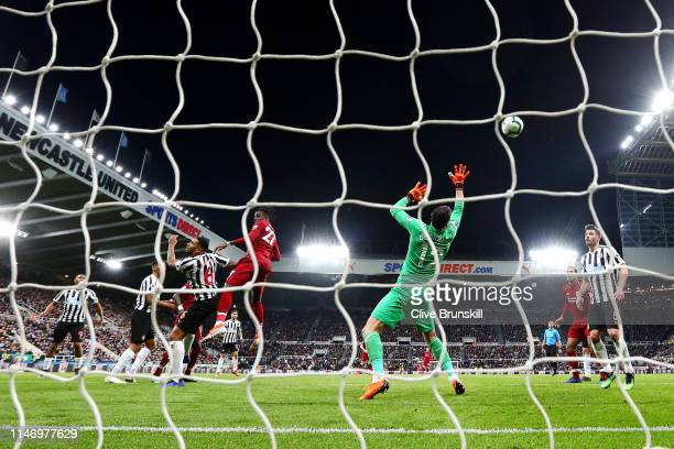 Divock Origi of Liverpool scores his team's third goal past Martin Dubravka of Newcastle United during the Premier League match between Newcastle...