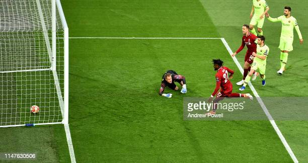 Divock Origi of Liverpool scores the first goal during the UEFA Champions League Semi Final second leg match between Liverpool and Barcelona at...