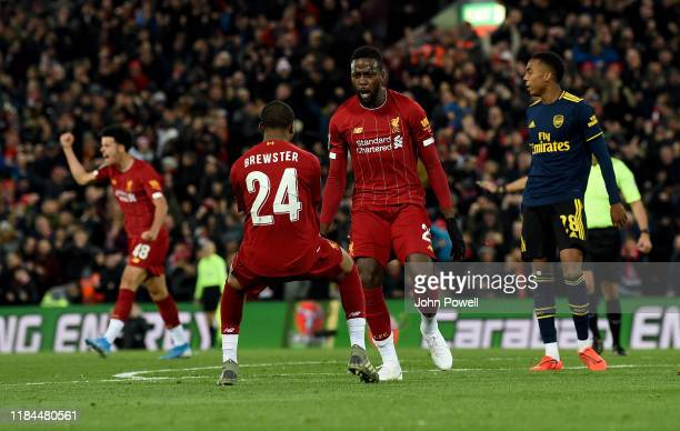 Divock Origi of Liverpool scores the forth goal and celebrates during the Carabao Cup Round of 16 match between Liverpool FC and Arsenal FC at...