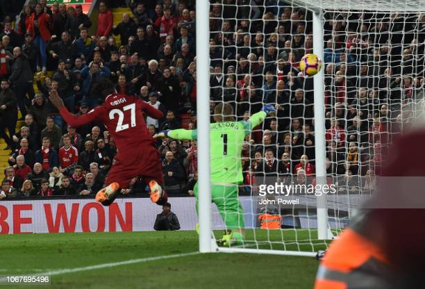 Divock Origi of Liverpool Scores the only Goal during the Premier League match between Liverpool FC and Everton FC at Anfield on December 2 2018 in...