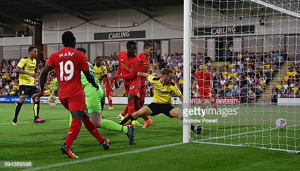 Divock Origi of Liverpool scores the opening goal during the EFL Cup match between Burton Albion and Liverpool at the Pirelli Stadium on August 23...