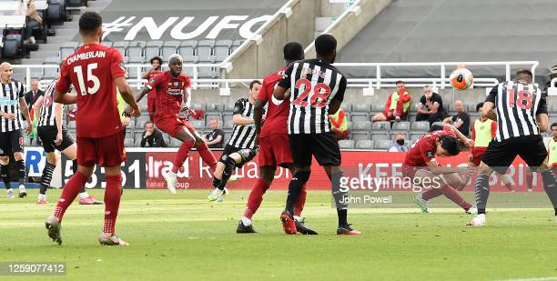Divock Origi of Liverpool scores the second goal making the score 12 during the Premier League match between Newcastle United and Liverpool FC at St...