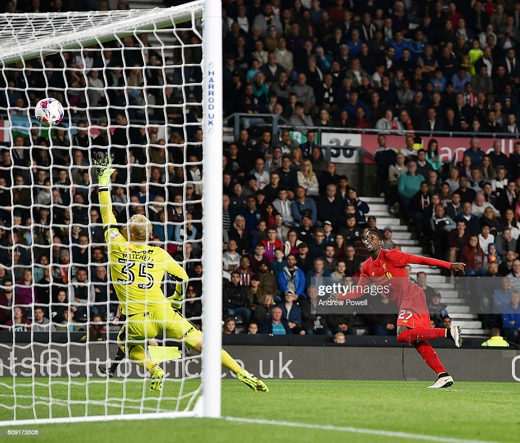Divock Origi of Liverpool scores the third during the EFL Cup third round match between Derby County and Liverpool at iPro Stadium on September 20, 2016 in Derby, England.