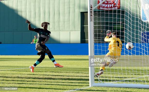 Divock Origi of Liverpool scoring a goal during a Pre-Season Friendly match between Sevilla and Liverpool at Fenway Park on July 21, 2019 in Boston,...