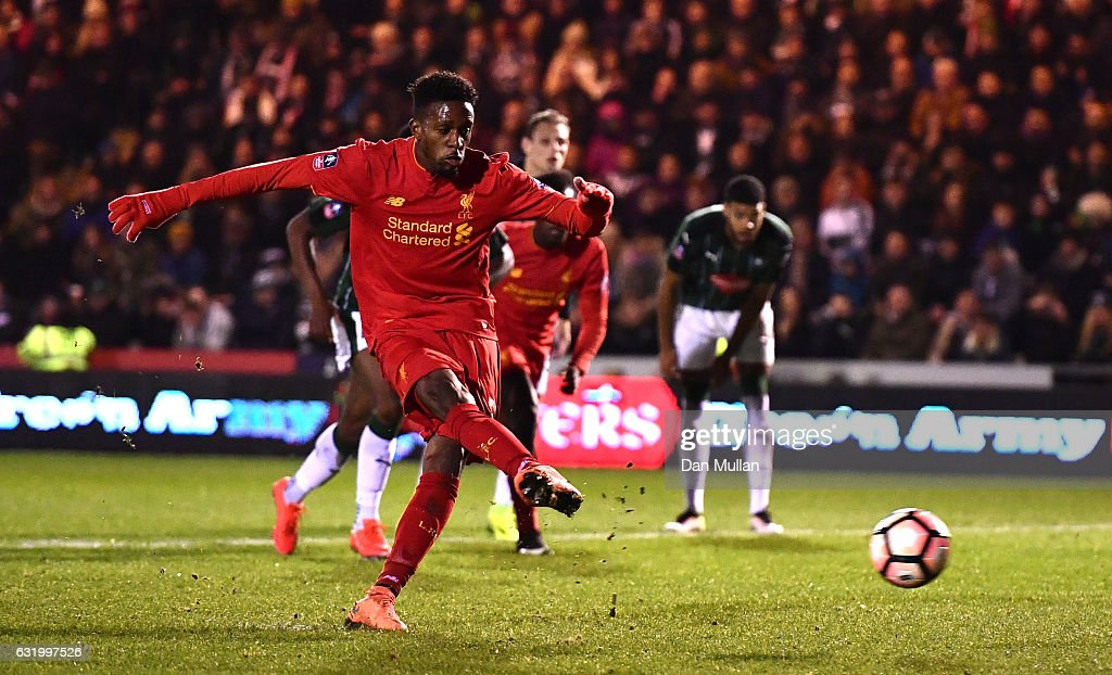 Divock Origi of Liverpool takes his penalty only for it to be saved by Luke McCormick of Plymouth Argyle during The Emirates FA Cup Third Round Replay match between Plymouth Argyle and Liverpool at Home Park on January 18, 2017 in Plymouth, England.