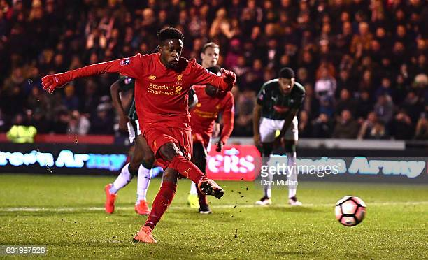 Divock Origi of Liverpool takes his penalty only for it to be saved by Luke McCormick of Plymouth Argyle during The Emirates FA Cup Third Round...