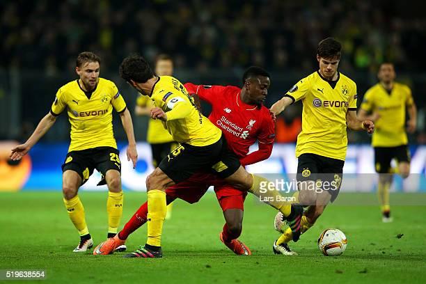 Divock Origi of Liverpool takes on Marcel Schmelzer , Mats Hummels and Julian Weigl of Borussia Dortmund during the UEFA Europa League quarter final...